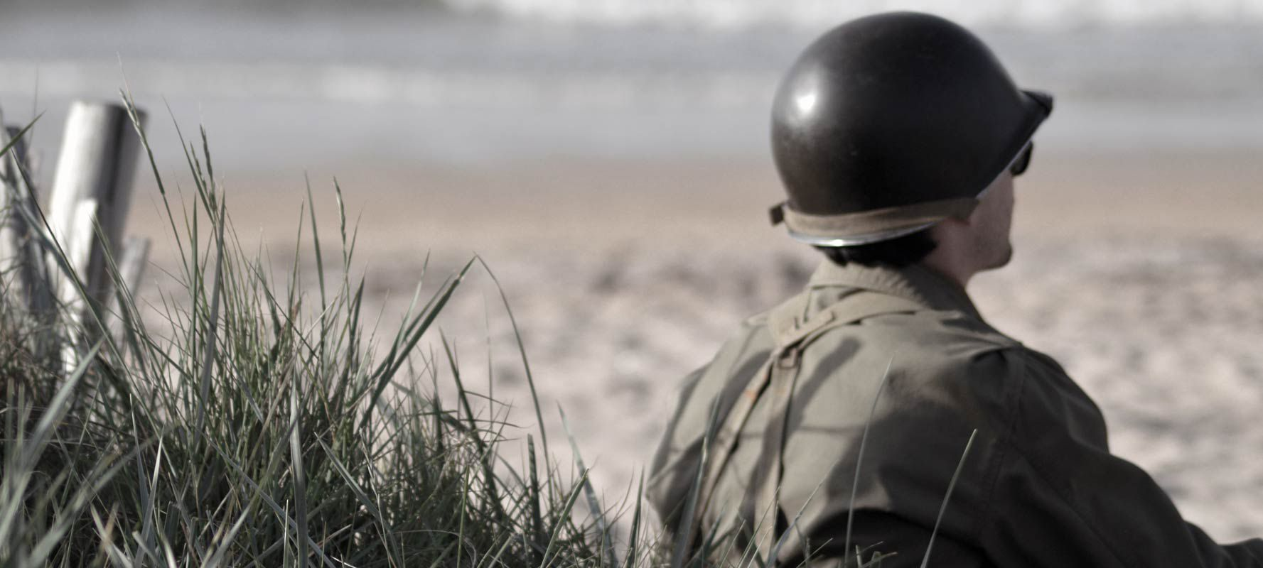 Soldier Reflecting On Beach